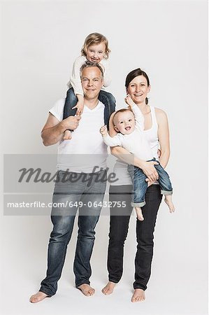 Smiling family posing together Stock Photo - Premium Royalty-Free, Image code: 649-06432755