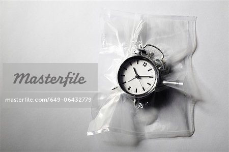 Alarm clock shrink wrapped in plastic Stock Photo - Premium Royalty-Free, Image code: 649-06432779