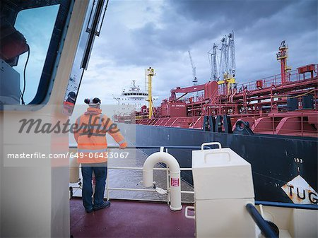 Tugboat worker standing on deck Stock Photo - Premium Royalty-Free, Image code: 649-06433067