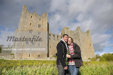 Couple hugging by medieval castle Stock Photo - Premium Royalty-Free, Image code: 649-06433139