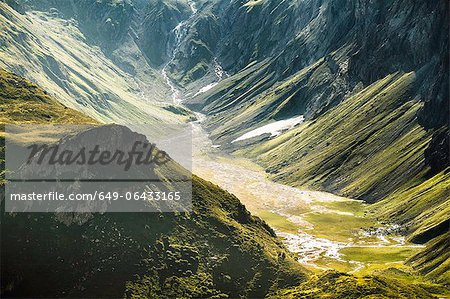 Aerial view of grassy rural valley Stock Photo - Premium Royalty-Free, Image code: 649-06433165