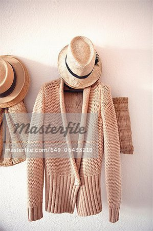 Knitted sweater and hat on hook Stock Photo - Premium Royalty-Free, Image code: 649-06433210