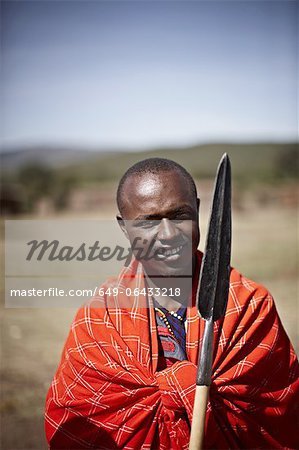 Maasai man holding shovel Stock Photo - Premium Royalty-Free, Image code: 649-06433218