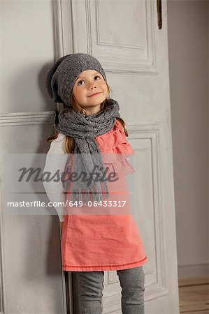 Smiling girl wearing hat and scarf Stock Photo - Premium Royalty-Free, Image code: 649-06433317