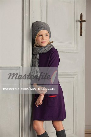 Girl wearing scarf and hat indoors Stock Photo - Premium Royalty-Free, Image code: 649-06433340