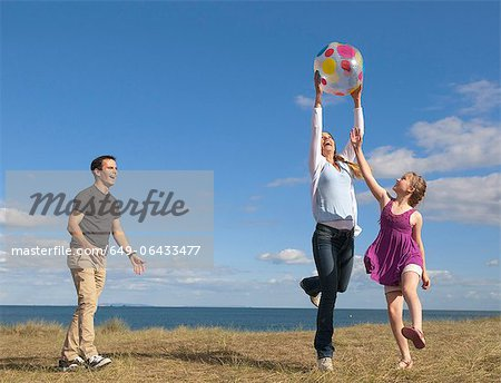 Family playing together outdoors Stock Photo - Premium Royalty-Free, Image code: 649-06433477