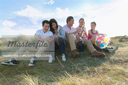 Family relaxing together outdoors Stock Photo - Premium Royalty-Free, Image code: 649-06433495
