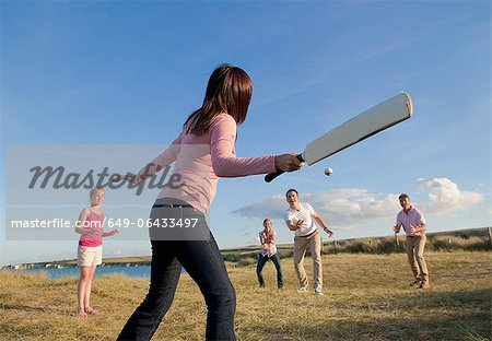Family playing cricket together outdoors Stock Photo - Premium Royalty-Free, Image code: 649-06433497