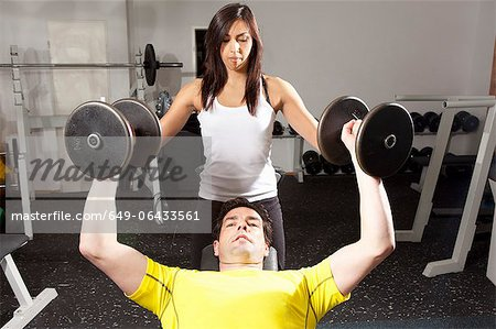 Man working with trainer at gym Stock Photo - Premium Royalty-Free, Image code: 649-06433561