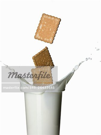 Cookies splashing into glass of milk Stock Photo - Premium Royalty-Free, Image code: 649-06433645