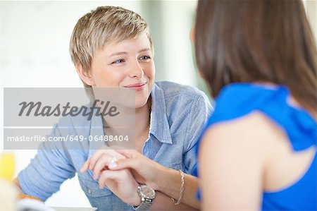 Smiling lesbian couple holding hands Stock Photo - Premium Royalty-Free, Image code: 649-06488404