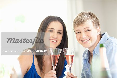 Women having champagne together Stock Photo - Premium Royalty-Free, Image code: 649-06488412
