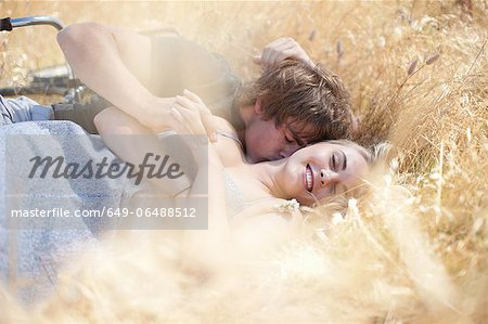 Couple relaxing in tall grass Stock Photo - Premium Royalty-Free, Image code: 649-06488512