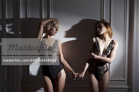 Women in lingerie holding hands Stock Photo - Premium Royalty-Free, Image code: 649-06488602