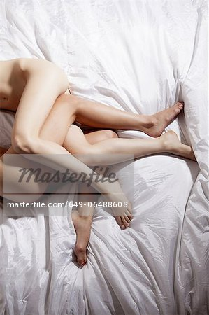 Womens naked legs in bed