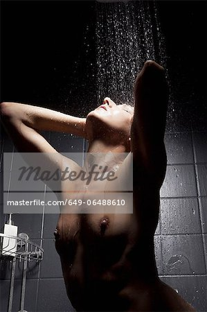 Woman rinsing her hair in shower Stock Photo - Premium Royalty-Free, Image code: 649-06488610