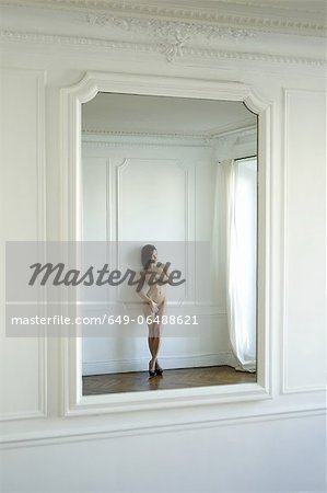 Nude woman reflected in mirror Stock Photo - Premium Royalty-Free, Image code: 649-06488621