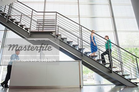 Business people walking in office Stock Photo - Premium Royalty-Free, Image code: 649-06488674