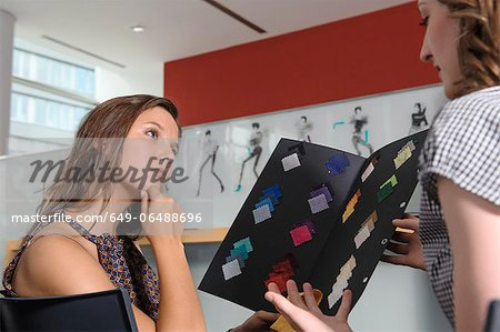 Businesswomen examining fabric swatches Stock Photo - Premium Royalty-Free, Image code: 649-06488696