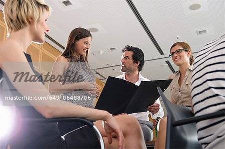Business people talking in office Stock Photo - Premium Royalty-Free, Image code: 649-06488706