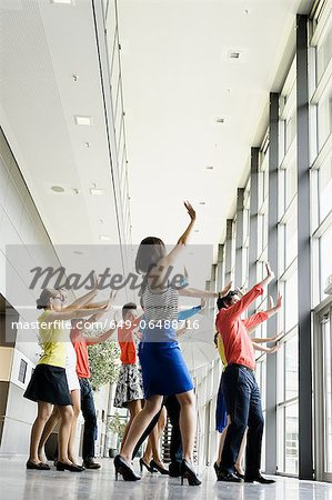 Business people dancing in office Stock Photo - Premium Royalty-Free, Image code: 649-06488716