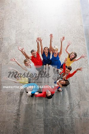 Overhead view of people cheering Stock Photo - Premium Royalty-Free, Image code: 649-06488729