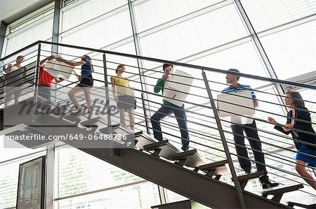 People passing boxes up stairs Stock Photo - Premium Royalty-Free, Image code: 649-06488736