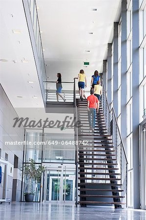 Business people climbing office stairs Stock Photo - Premium Royalty-Free, Image code: 649-06488742