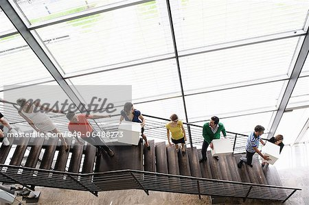 People passing boxes up stairs Stock Photo - Premium Royalty-Free, Image code: 649-06488773