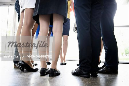 Business peoples legs in office Stock Photo - Premium Royalty-Free, Image code: 649-06488782