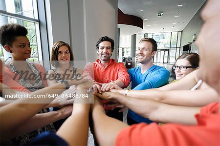 Business people cheering in office Stock Photo - Premium Royalty-Free, Image code: 649-06488784