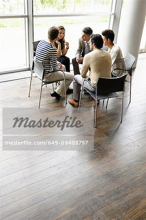 Business people talking in office Stock Photo - Premium Royalty-Free, Image code: 649-06488797