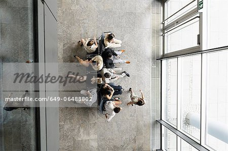Business people playing musical chairs Stock Photo - Premium Royalty-Free, Image code: 649-06488802