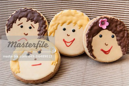Cookies decorated with faces Stock Photo - Premium Royalty-Free, Image code: 649-06489013