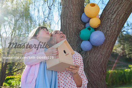 Mother and daughter holding birdhouse Stock Photo - Premium Royalty-Free, Image code: 649-06489029