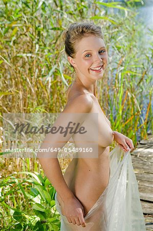 Nude woman in sheer towel Stock Photo - Premium Royalty-Free, Image code: 649-06489160