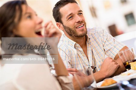Friends talking at dinner Stock Photo - Premium Royalty-Free, Image code: 649-06489216