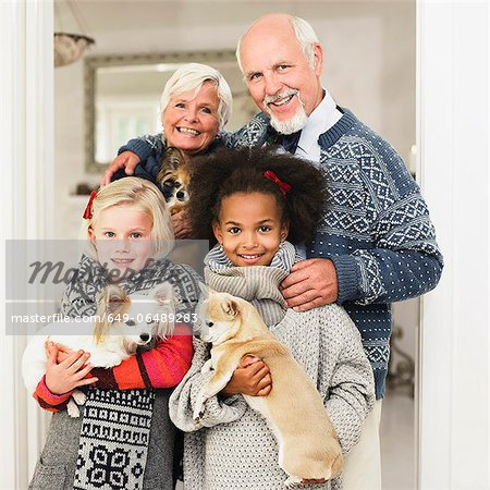 Family posing for Christmas picture Stock Photo - Premium Royalty-Free, Image code: 649-06489283