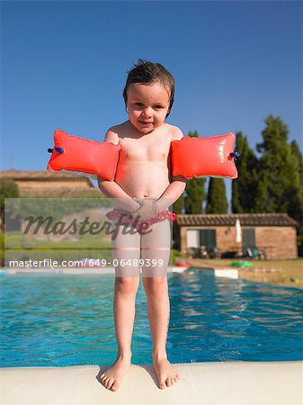 Girl in floaters at swimming pool Stock Photo - Premium Royalty-Free, Image code: 649-06489399