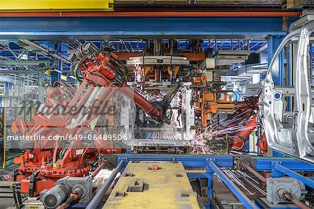 Robots welding van body in car factory Stock Photo - Premium Royalty-Free, Image code: 649-06489506
