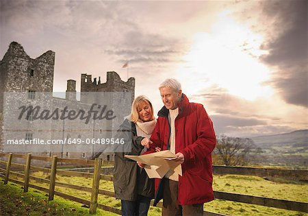 Older couple reading map by castle Stock Photo - Premium Royalty-Free, Image code: 649-06489546