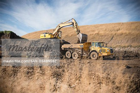 Excavator working at surface coal mine Stock Photo - Premium Royalty-Free, Image code: 649-06489582