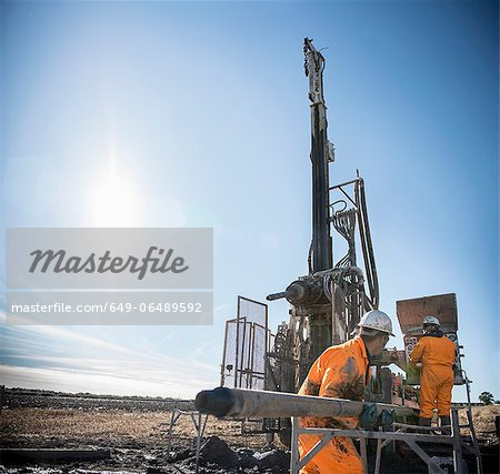 Workers on drilling rig at coal mine Stock Photo - Premium Royalty-Free, Image code: 649-06489592