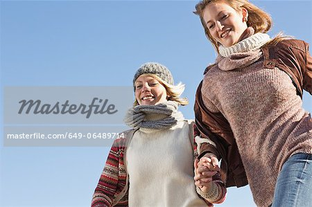 Smiling women running outdoors Stock Photo - Premium Royalty-Free, Image code: 649-06489714