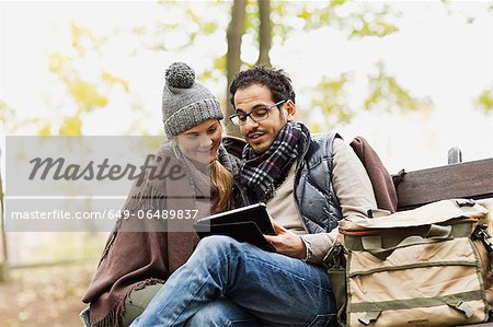 Couple using tablet computer in park Stock Photo - Premium Royalty-Free, Image code: 649-06489837