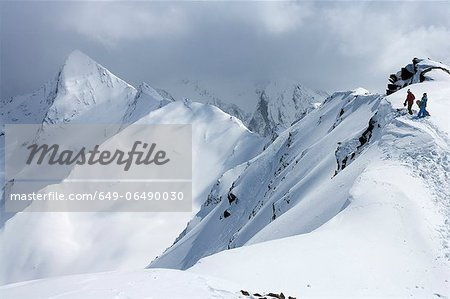 Snowboarders climbing snowy slope Stock Photo - Premium Royalty-Free, Image code: 649-06490030