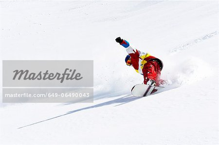 Snowboarder on snowy slope Stock Photo - Premium Royalty-Free, Image code: 649-06490043