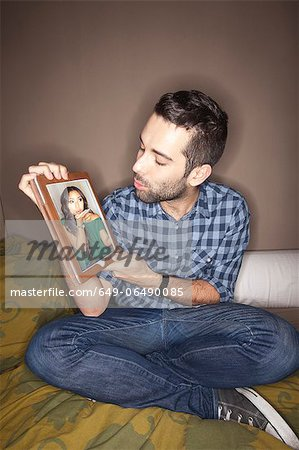 Man with girlfriend on tablet computer Stock Photo - Premium Royalty-Free, Image code: 649-06490085