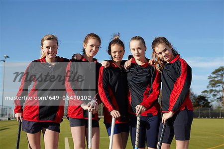 Lacrosse team smiling together Stock Photo - Premium Royalty-Free, Image code: 649-06490102