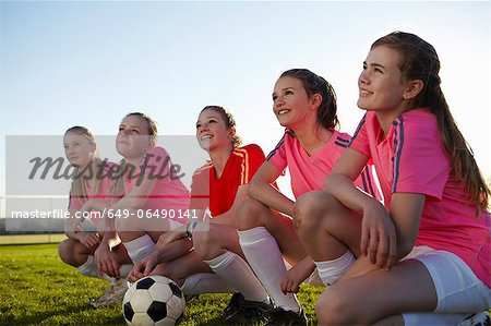 Football team smiling together in field Stock Photo - Premium Royalty-Free, Image code: 649-06490141